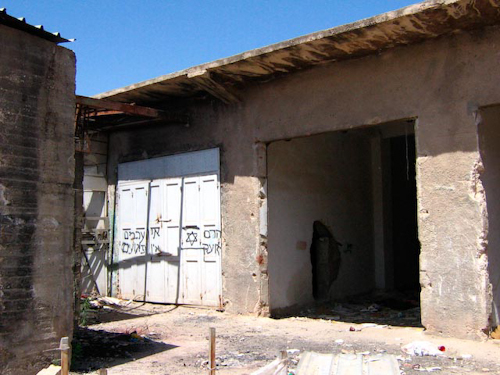 Destroyed shop in the buffer zone