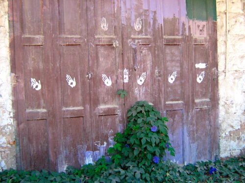 Handprints on doors at the site of the memorial
