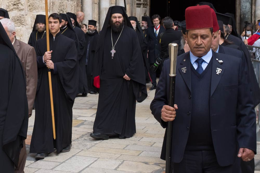 Procession heading out of the Church Of The Holy Sepulchre