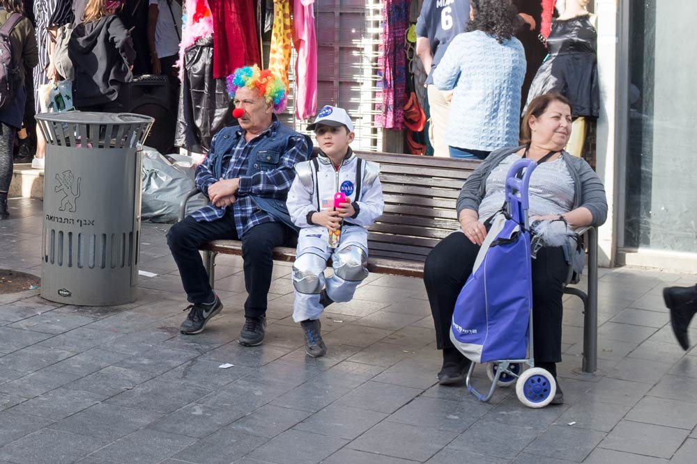 Sitting on a bench on Jaffa Road in Jerusalem - dressed for Purim